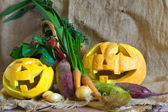 Halloween pumpkin and harvested vegetables — Stock Photo
