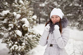 Young woman at wintry park — Stok fotoğraf