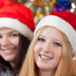 Royalty-Free Stock Photo: girls in santa hats in christmas