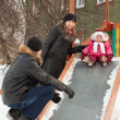 parents with  toddler playing on slide  — Foto de Stock