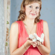 Woman with armful of bulb — Stockfoto #13652729