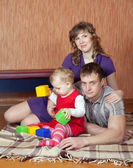 Parents and child relaxing at home — Stock Photo