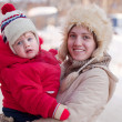 Happy mother with toddler in winter — Stock Photo #13665355