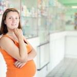 Pregnant woman at pharmacy — Stock Photo #13664369