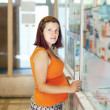 Pregnant woman buys drugs at pharmacy — Stock Photo #13664371