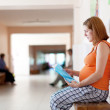 Pregnant woman at the clinic — Stock Photo #13664374