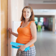 Pregnant woman at the clinic — Stock Photo #13664381