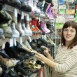 Stock Photo: Woman chooses shoes
