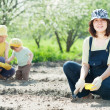 Women with child works at garden — Stock Photo