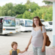 Family at bus station — Stock Photo