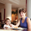 Family  having breakfast in  restaurant — Stock Photo