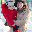 happy mother with toddler  in winter  — Stock Photo