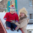 Happy mother with toddler on slide — Stock Photo #13665357