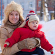 Mother with toddler in winter — Stock Photo #13665361