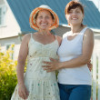 Two  women  in front of her  residence — Stock Photo