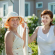 Women near fence wicket — Stock Photo