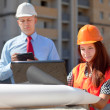 Two architects works in front of building site — Stock Photo #13665455