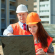 Architects works in front of building site — Stock Photo #13665457