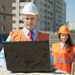 White-collar workers works on the building site — Stock Photo #13665460