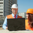 White-collar workers works on the building site — Stock Photo #13665465