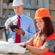 Two builders works at construction site  — Stockfoto