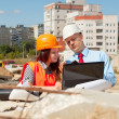 Two architects in front of building site — Stock Photo #13665478