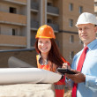 Stock Photo: Builders works at construction site