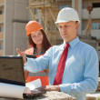 Stock Photo: Two workers works on the building site
