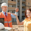 Builder presents the keys to girl  — Stock Photo