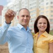 Happy family in front of new home - Stock Photo