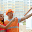 Portrait of builders at building site — Stock Photo #13665590