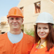 Builders works at construction site - Stock Photo