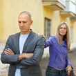 Stock Photo: Couple after quarrel at street