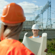 Two workers at electrical power station — Stock Photo