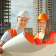 Two happy builders in hardhat — Stock Photo