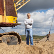 Royalty-Free Stock Photo: tractor operator at sand pit