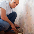 Man repairs the socket — Stock Photo