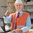 Happy builder in building site - Stock Photo