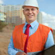 White-collar worker at the building site — Stock Photo #13665743