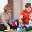 Stock Photo: Happy family plays in home interior