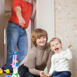 Family of three in home — Stock Photo #13667195