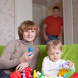 mother and child plays with toys   — Stock Photo