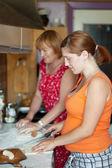 Two women cooks pie — Stock Photo