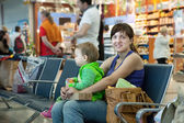 Mother and child at airport — Stock Photo