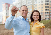 Happy family in front of new home — Stock Photo