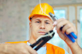 Electrician installing electricity — Stock Photo