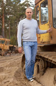 Tractor operator at workplace — Stock Photo