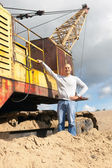 Worker at sand pit — Stock Photo