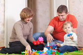 Happy family plays in home interior — Stock Photo