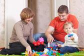 Mutlu bir aile ev iç çalış — Stok fotoğraf